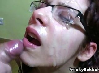 Filthy brunette whore gets her glasses covered with cum in this buk...