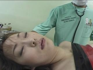 Crazy doctor ties up this japanese babe for weird exam