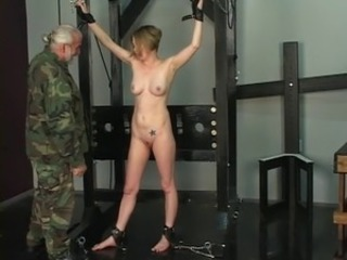 Hard spanking turns this slave soldier girl's ass bright red in dungeon