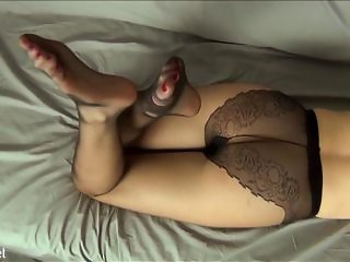 Mlle Fanchette is wearing black nylon pantyhose and nothing else. She enjoys bringing her butler at the edge of orgasm with her feet again and again.