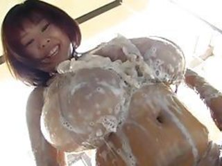 Japanese cutie with giant tits soaps and oils up tubes