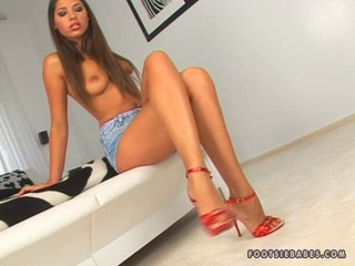 Tall brunette nymph Zafira getting naked and lusty on her deliciously hot feet