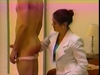 Man in panties spanked by businesswoman
