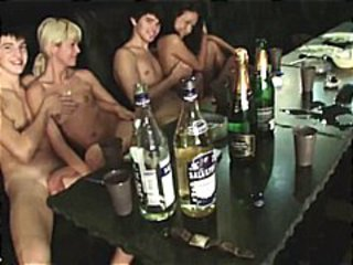 Students are naked and drinking and playing pool in this clip