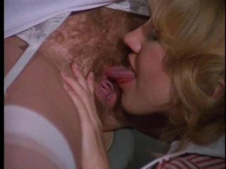 Foxy Retro Nurse Sucks and Fucks a Patient's Cock