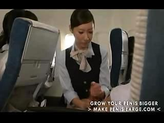 Japanese stewardess gives a passenger a handjob during the flight