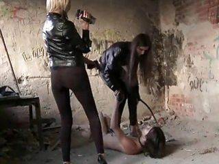 Slutty bitches in leather clothes torturing their slave