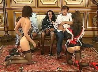Two maids serve their Mistress' guests