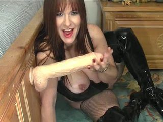 Horny chick plays with a big ...