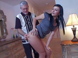 Black Haired Cutie Ashli Orion Takes Off Her Dress And Poses In Sexy Panties In Front Of Her Older Employer. Shes A Babysitter Who Gets Tricked Into Sex With Aged Man. She Sucks His Mature Dick On Her Knees.
