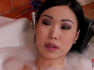 Asian Chick Nicoline Takes A Bubble Bath With Her Fuck Buddy. She Finds His Hard Dick In Front Of Her Face. Nicoline Wraps Her Lips Around His Meat Pole!