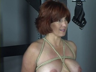 Nude redhead with nice tits and ass is whipped in bdsm...