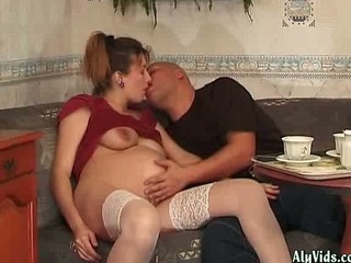 Pregnant babe doing blowjob and gets drilled
