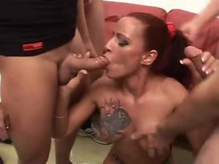 Inked up redhead in a big gangbang