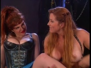 Dominatrix with red hair ass whips girl
