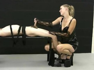 Blonde mistress jerks off her...