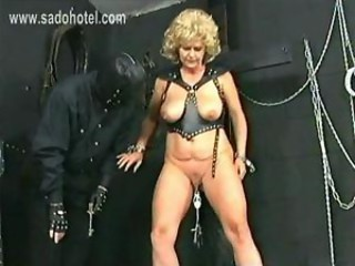 Older slave with big tits got metal clamps with lots of...