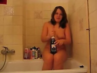 girl with bottle in bathroom