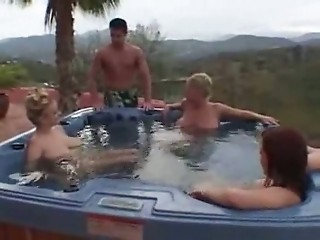Three busty MILF and a lucky guy in pool