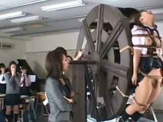 Asian slut tied encircling strongest wheel and taunted