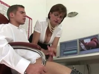 Femdom mature fetish bitch sucks on cock