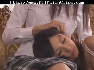 Japanese lesbo sluts have sex with strapon