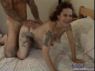 Diana is a very tattooed mature woman