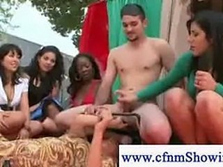 CFMN girls play with guys cock in public