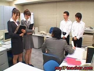 Junna and Erika sucking in office