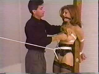 Redhead In Bondage And Tit Torture