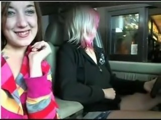 lesbians inside car in parking lot