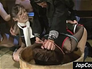 Two Asian slaves get tied up and tortured in a water barrel