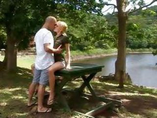 Hot blonde by the lake sitting on a large dick tubes