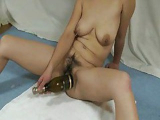 Fitting the bottle up her cunt tubes