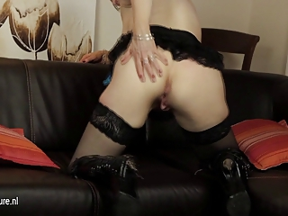 European mature mom playing with her dildo on the