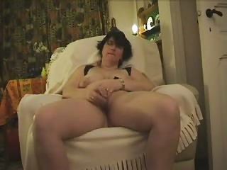 Mature Monica masturbates with glass dildo and