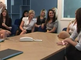 Movie showing an office guy being made to strip in front..