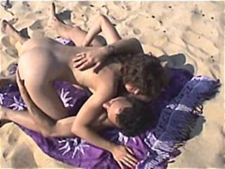Out in the dunes this couple decides to have sex on the beach