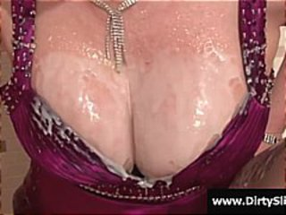 Busty redhead gets a fake dick to milk and jam in her pussy