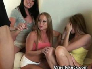 Clothed Women Share Cock At Reverse Gangbang
