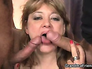 Two fellows pick back mature and bang her hard