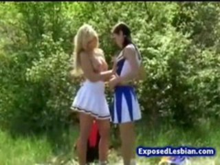 Naughty busty cheerleaders camping outdoors and licking out each others twat