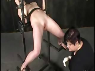 Blonde gets tied up and tortured by her sadistic master and then watches
