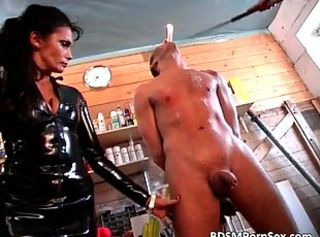 Rough BDSM sex where guy is tied while two mistress in leather