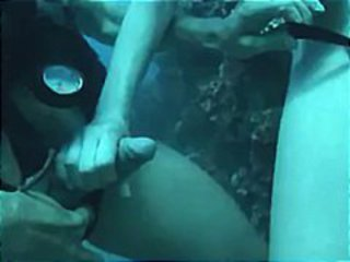 Brunette goes diving and sucks and fucks hard cock under water