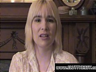 Blonde crossdresser Alice is posing in a see through blouse