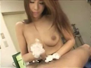 Asian topless nurse handjob in doctors office