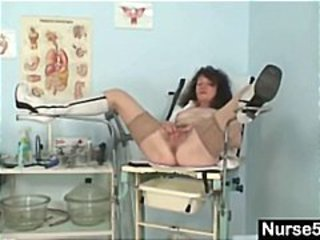 Nasty old brunette granny gives her hairy pussy a speculum exam