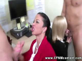 Two classy clothed secretaries help their bosses to relax