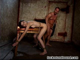 This Brunette Teen Gets Tied Up And Made To Fuck And Suck His Cock